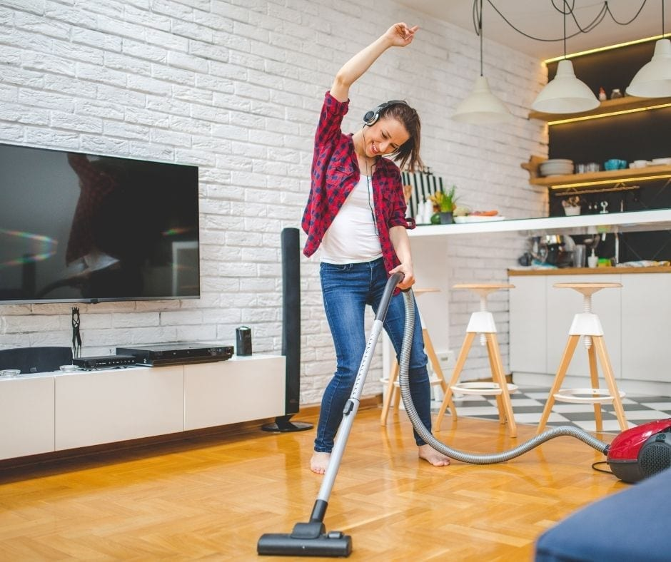 Woman dancing and cleaning